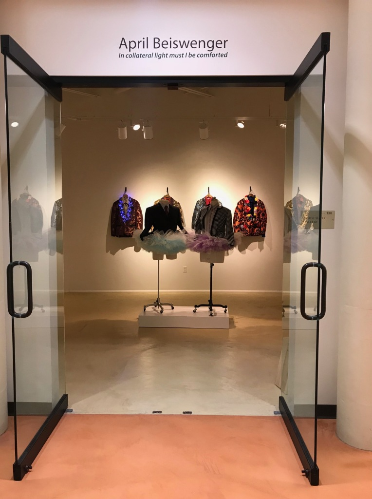 Gallery image featuring mannequins with clothing designs on them, including hand-sewn dress jackets and tutus