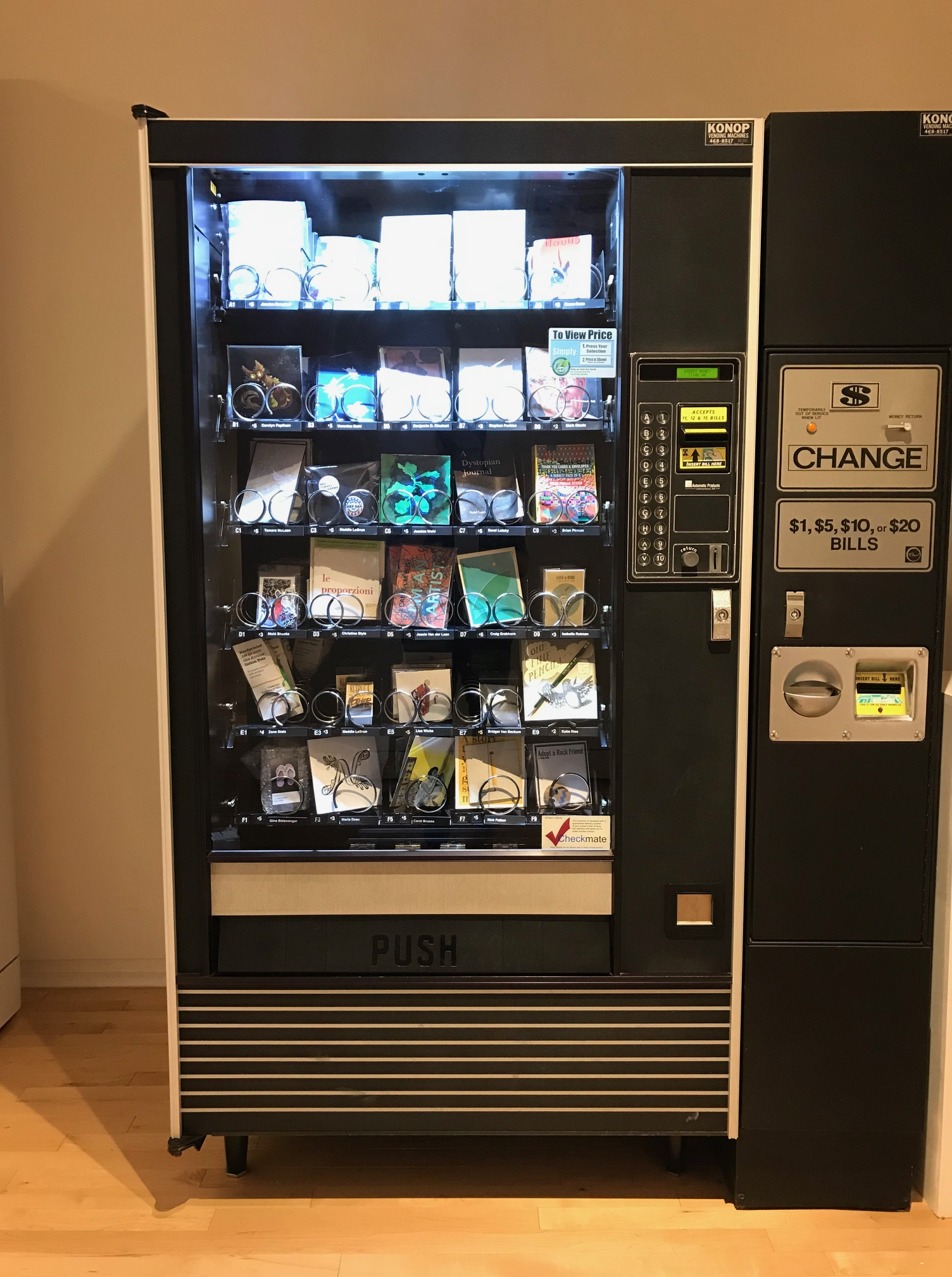 A snack vending machine full of works of art.